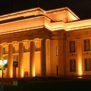 Auckland War Memorial Museum at night; it's lit up by nightlights