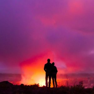 two people admiring sunset at volcanoes national park