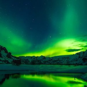 A person looking at the northern lights