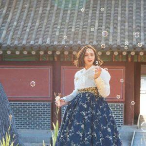 girl wearing hanbok posing in palace