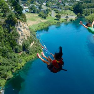 people bungy jumping and extreme swinging