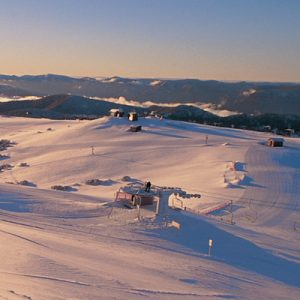 aerial view of mount buller lifts during sunset
