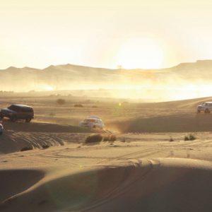 land cruisers dune bashing for the morning safari tour