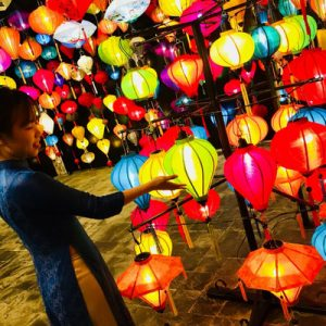 woman posing with lanterns