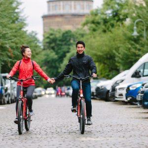 couple biking around berlin