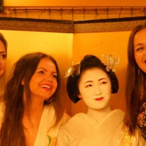 women taking photos with a maiko