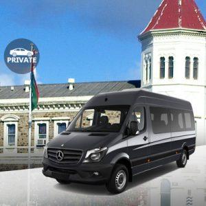 black mercedes benz van with background of buildings