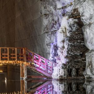 a bridge and a lake inside a salt mine