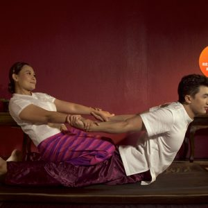 man getting a massage from female masseuse zira spa chiang mai