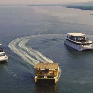 three boats sailing across waters divar island goa