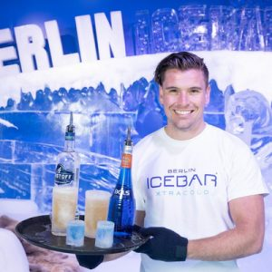 waiter holding a tray of drinks at the berlin ice bar