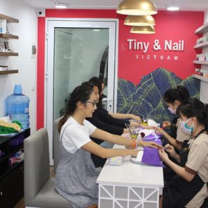 women getting their nails done