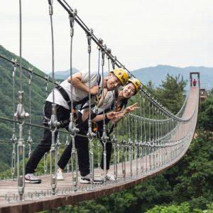 couples posing at the bridge