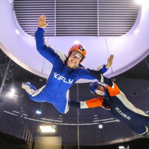 a woman and her guide indoor skydiving