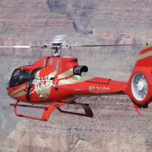 an Ace of Adventure helicopter flying around the Grand Canyon