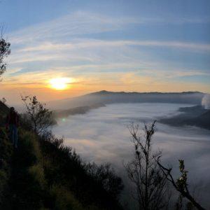 people hiking in mount bromo during sunrise