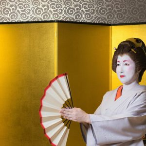 geisha holding a fan
