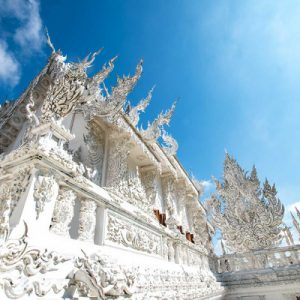 blue skies and white temple