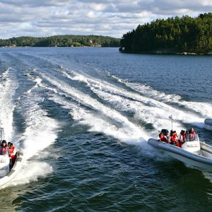 four speedboats sailing near stockholm archipelago
