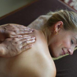 woman enjoying a massage at tejas spa