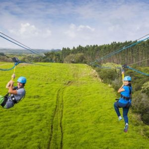 couple ziplining in hawaii