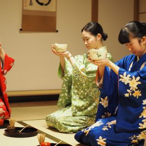 3 japanese girls having tea ceremony