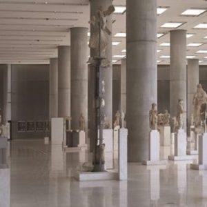 a floor full of Greek statues in acropolis museum