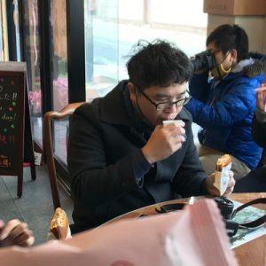 people eating Japanese snacks