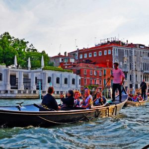 a group of tourists on a gondola in venice