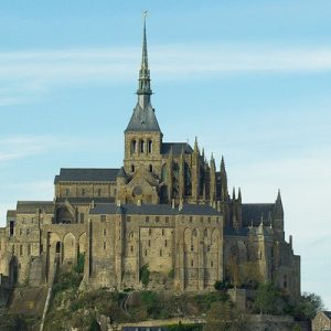 a view of the looming Mont-Saint-Michel Abbey from afar