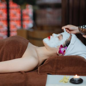 woman having a facial at serene spa