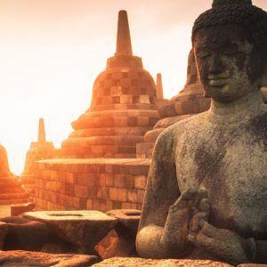 sunrise at Borobodur Temple with a close up of a Buddhist statue