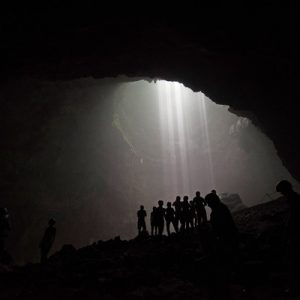 group of tourists in jomblang cave