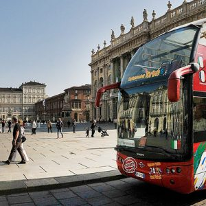 City Sightseeing Torino Bus next to buildings