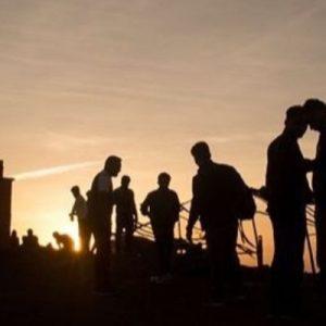 trekkers at mount kalsubai mountaintop during sunrise