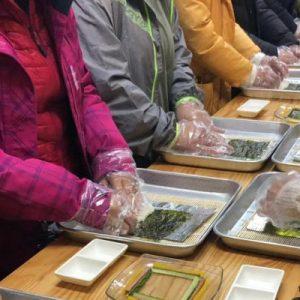 guests learning to make gimbap at SAMYONG Korean Food Culture Experience Hall