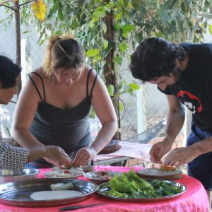 Guests and locals prepare the ingredients