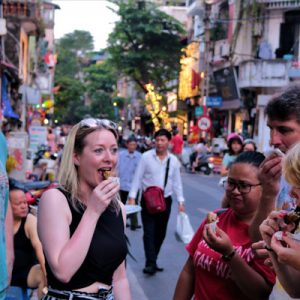 people enjoying food in the street