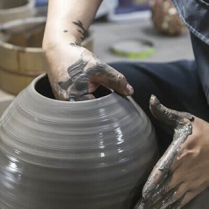 a person making a bizen ware