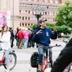 tour guide explaining nazi berlin bike tour