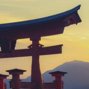 Itsukushima Shrine's torii gate during sunset
