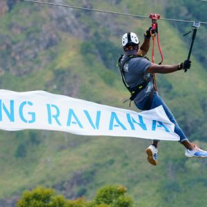 man ziplining with flying ravana map in ella