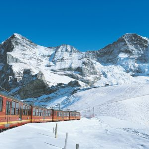 a train a snow capped mountain