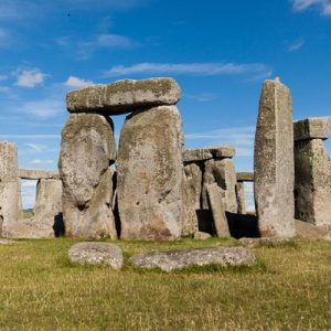 Stonehenge with grass and blue sky