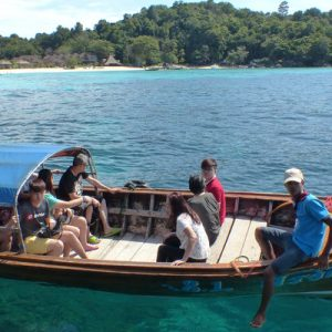 people riding tailboat for transfers Between Langkawi Island and Koh Lipe Island