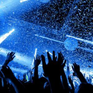 people dancing in a Las Vegas nightclub with blue lights