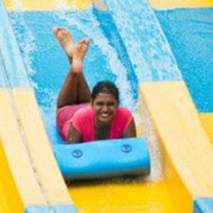 woman sliding in water world in bangalore
