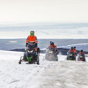 tour group snowmobiling on mýrdalsjökull glacier