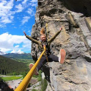girl swinging in canyon swing interlaken