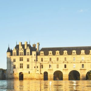 a shot of Château de Chenonceau from a distance; you can also see the river it stands over